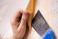 Hands removing old wallpaper with spatula removal of wallpapers Royalty Free Stock Photography