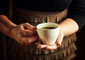 Hands of senior woman holding cup of coffee Royalty Free Stock Image