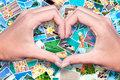 Hands in the shape of a heart and holiday photos tropical Royalty Free Stock Photo