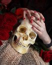 Hands and skull of young woman Royalty Free Stock Photo