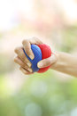 Hands squeezing a stress balls Royalty Free Stock Photo
