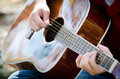 Hands strumming guitar Royalty Free Stock Photo