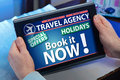 Hands on a tablet looking at a page online travel agency Royalty Free Stock Photo