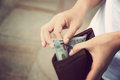 Hands taking out money from wallet Royalty Free Stock Photo