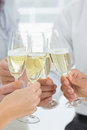 Hands toasting with champagne extreme closeup Royalty Free Stock Photography