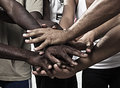 Hands together in union closeup portrait of group with mixed race people with Royalty Free Stock Image