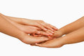 Hands on top of each other showing unity with their together concept successful business people Stock Photo