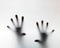 Hands touching frosted glass. Conceptual scream for help Royalty Free Stock Photo