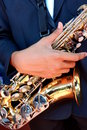 Hands on a trumpet close up. Royalty Free Stock Photo