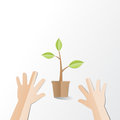 Hands try to holding young plant with Happy Earth Day text, pape Royalty Free Stock Photo