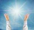 Hands trying to reach on the sky with sunshine rays Royalty Free Stock Photo