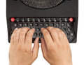 Hands on a typewriter keyboard with white background Royalty Free Stock Images