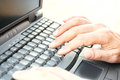 Hands typing on laptop keyboard close up of male Royalty Free Stock Photography