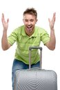 Hands up man with travel suitcase half length portrait of his and silver isolated on white Stock Photography