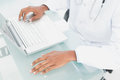 Hands using laptop at medical office close up of doctor s Royalty Free Stock Images