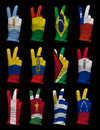 Hands victory sign gloves decorated south america flags Stock Photography