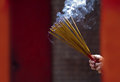 Hands Waving Smoking Incense Sticks at Temple Royalty Free Stock Images