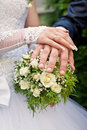 Hands on the wedding bouquet Stock Photo
