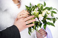 Hands with wedding gold rings and flowers happy newlyweds Stock Photos