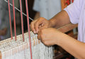 Hands were weaving are the woven yarn Royalty Free Stock Photography