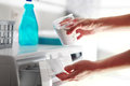 Hands of woman that fills detergent Royalty Free Stock Photo