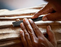 Hands woodcarver with the tool close up Stock Images