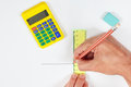 Hands at work with a pencil and ruler on white sheet of paper Royalty Free Stock Photo