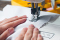 Hands of young girl on sewing machine Royalty Free Stock Photo