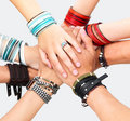 Hands of young guys and girls showing unity Stock Photos