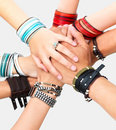 Hands of young guys and girls showing unity Royalty Free Stock Photos