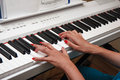 Hands of a young woman playing the piano Royalty Free Stock Photo