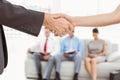 Handshake Besides People Waiti...
