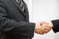Handshake of business partners man and woman in the office Stock Images
