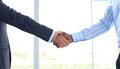 Handshake business people shaking hands in office Stock Images