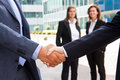 Handshake in front of business people Stock Image