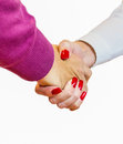Handshake man and woman closeup on white background Royalty Free Stock Image