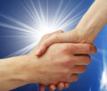 Handshake and the sun concptual Royalty Free Stock Images