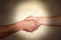 Handshake symbolizing the relationships between people Royalty Free Stock Photo