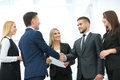 Handshake to seal a deal after a job recruitment meeting in a of Royalty Free Stock Photo