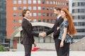 Handshake of two business men meeting outdoors Stock Photo