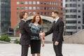 Handshake of two business men meeting outdoors Stock Photos