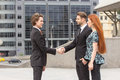 Handshake of two business men meeting outdoors Royalty Free Stock Image
