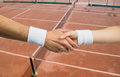 Handshake between two tennis player in a competition take with court background Royalty Free Stock Image