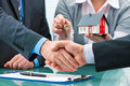 Handshakes with customer after contract signature estate agent shaking hands Stock Photography
