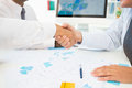 Handshaking at meeting close up of business partners Royalty Free Stock Photo