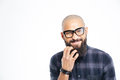 Handsome african american man in glasses scratching his beard closeup of baldheaded young Stock Photo