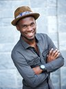 Handsome african american man smiling with arms crossed Royalty Free Stock Photo