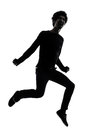 Handsome african young man jumping screaming silhouette Royalty Free Stock Photo