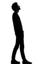 Handsome african young man standing looking up smiling silhouett Royalty Free Stock Images