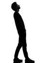 Handsome african young man standing looking up surprise silhouet one in silhouette studio isolated on white background Stock Images